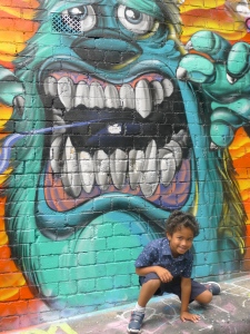 My cousin Joshua loving posing with Sully in Caledonian Laneway.